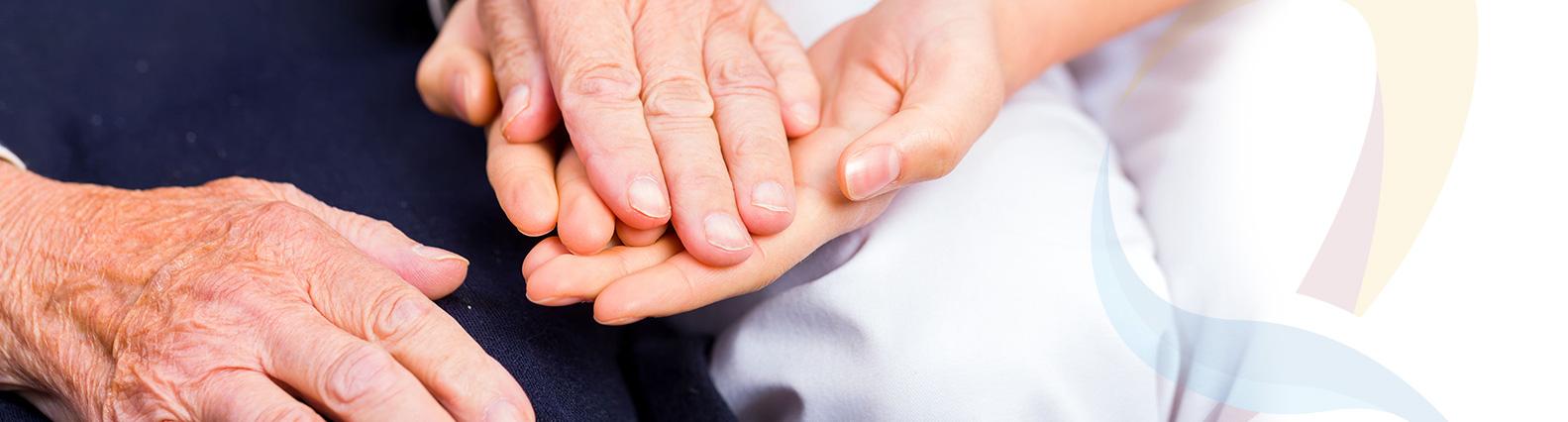 Handen houden elkaar vast Logo Reumazorg ZWN